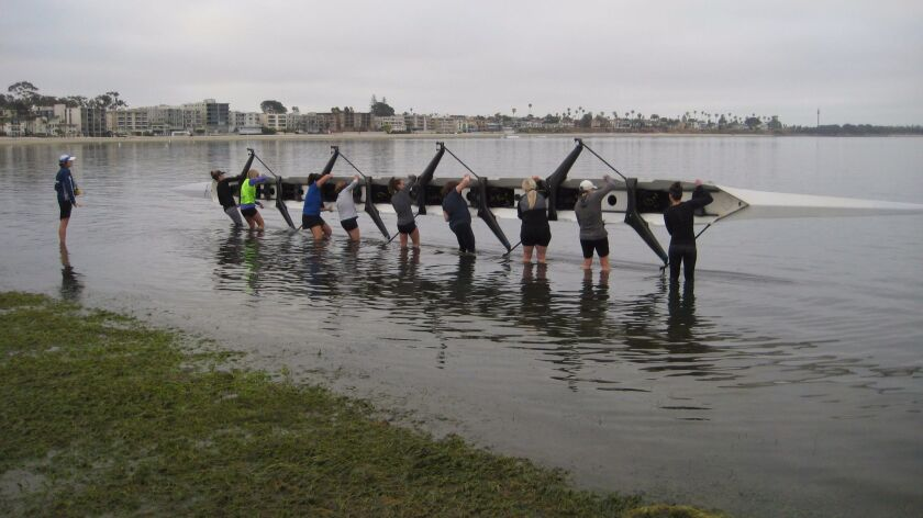 ZLAC rowers prepare for an early morning excursion Wednesday, June 26 along Mission Bay.