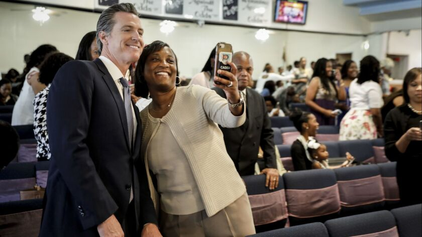 Laphonza Butler takes a selfie with Lt. Gov. Gavin Newsom during his campaign for governor in June.