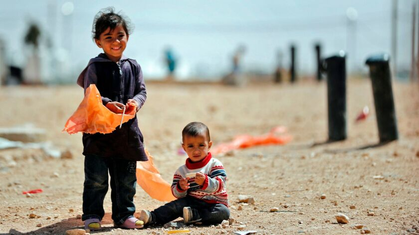 Syrian refugees at the Zaatari camp, which shelters about 80,000 Syrians on the Jordanian border wit
