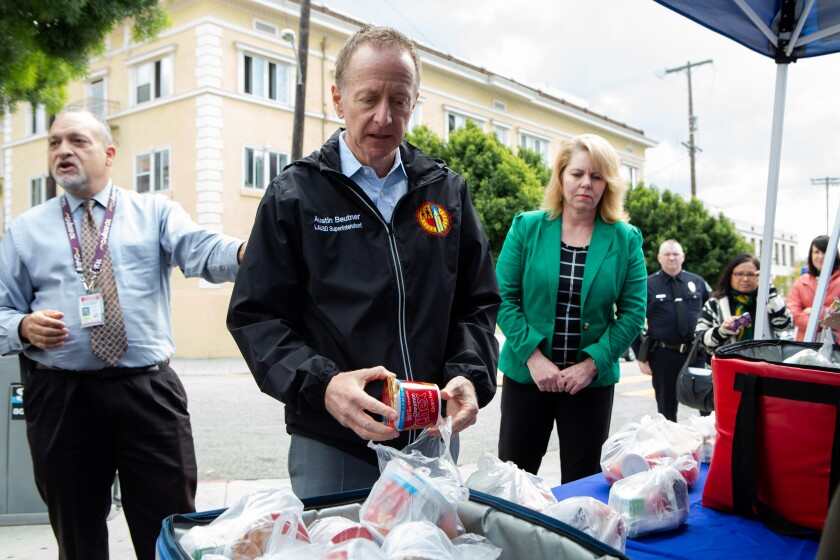 LAUSD Supt. Austin Beutner gives a tour of a food distribution location at John Liechty Middle School in downtown Los Angeles on March 17.