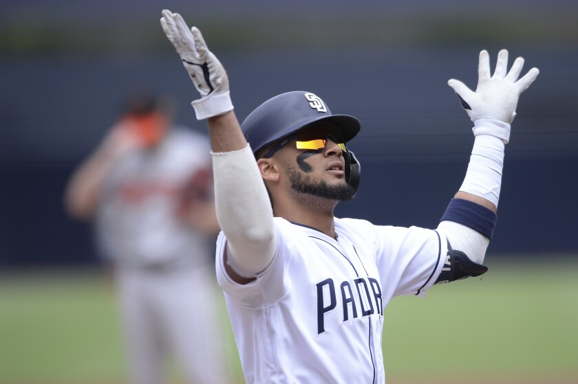 San Diego Padres' Fernando Tatis Jr. gestures after hitting a home run during the first inning of a baseball game against the Baltimore Orioles Tuesday, July 30, 2019, in San Diego.