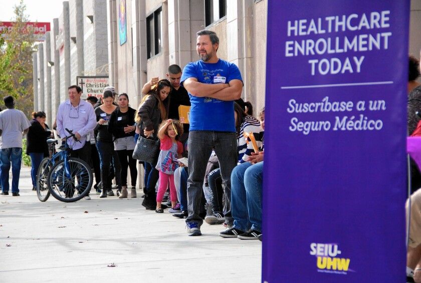 Increasing access to healthcare among Americans parallels a major expansion in health insurance coverage that began in 2014 through the health law often called Obamacare. Above, an Obamacare enrollment event in L.A. in November.