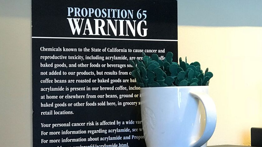 A posted Proposition 65 warning sign at a Starbucks coffee shop in Burbank, on March 30.