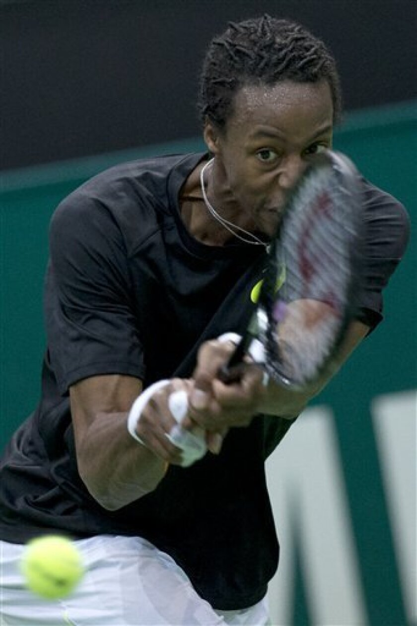Gael Monfils of France returns a shot against  Juan Martin del Potro of Argentina at the ABN AMRO world tennis tournament at Ahoy Arena in Rotterdam, Netherlands, Tuesday Feb. 12, 2013. Del Potro won in two sets, 6-3, 6-4. (AP Photo/Peter Dejong)