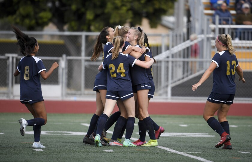 Del Norte senior defender Lauren Wheeler (center) is congratulated by teammates after scoring a second-half goal.