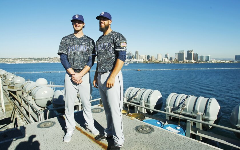 Padres Wil Myers, left, pitcher James Shields unveils the team's new blue digital camouflage tops which are modeled after the US Navy's working uniforms, often called blueberries.