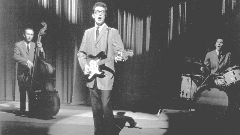 Joe B. Mauldin, playng stand-up bass behind Buddy Holly