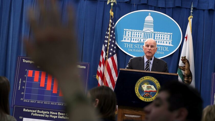 Gov. Jerry Brown speaks to reporters during a Thursday news conference where he revealed his revised state budget.