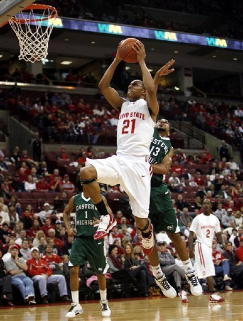 Ohio State's Evan Turner (21) goes up for a shot as Eastern Michigan's Antonio Green (13) defends during the first half of an NCAA college basketball game against Eastern Michigan Saturday, Dec. 5, 2009, in Columbus, Ohio. Turner was injured on the play. (AP Photo/Terry Gilliam)