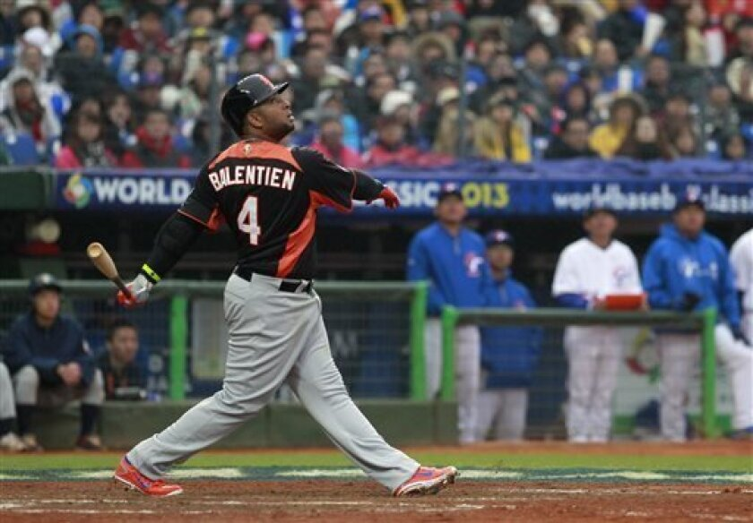 FILE - In this March 3, 2013 file photo, The Netherlands' Wladimir Balentien (4) follows a fly ball against Taiwan in the fifth inning of a World Baseball Classic second round game at the Intercontinental Baseball Stadium in Taichung, Taiwan. Balentien hit two home runs Tuesday, Aug. 27, 2013, to m
