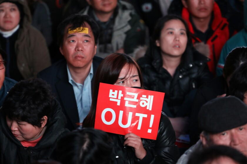 Thousands of South Koreans take to the streets of Seoul on Nov. 12, 2016, to demand the resignation of President Park Geun-hye.