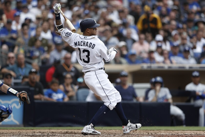 Manny Machado strikes out in the ninth inning of Thursday's home finale against the Dodgers.