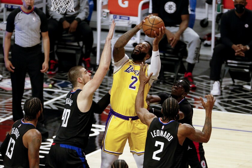 Los Angeles Lakers' Andre Drummond (2) shoots under pressure from Los Angeles Clippers' Ivica Zubac (40) and Kawhi Leonard (2) during the second half of an NBA basketball game Thursday, May 6, 2021, in Los Angeles. (AP Photo/Ringo H.W. Chiu)