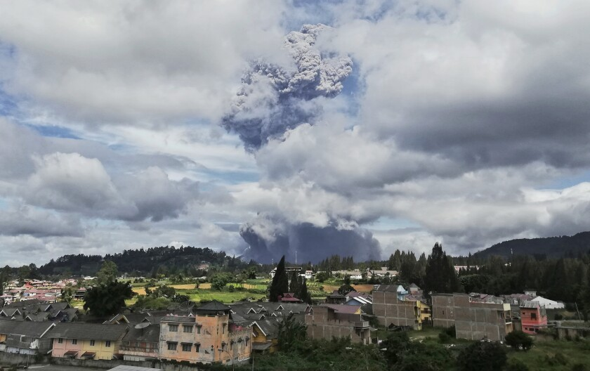 Indonesia's Mount Sinabung spews volcanic materials into the air Monday.