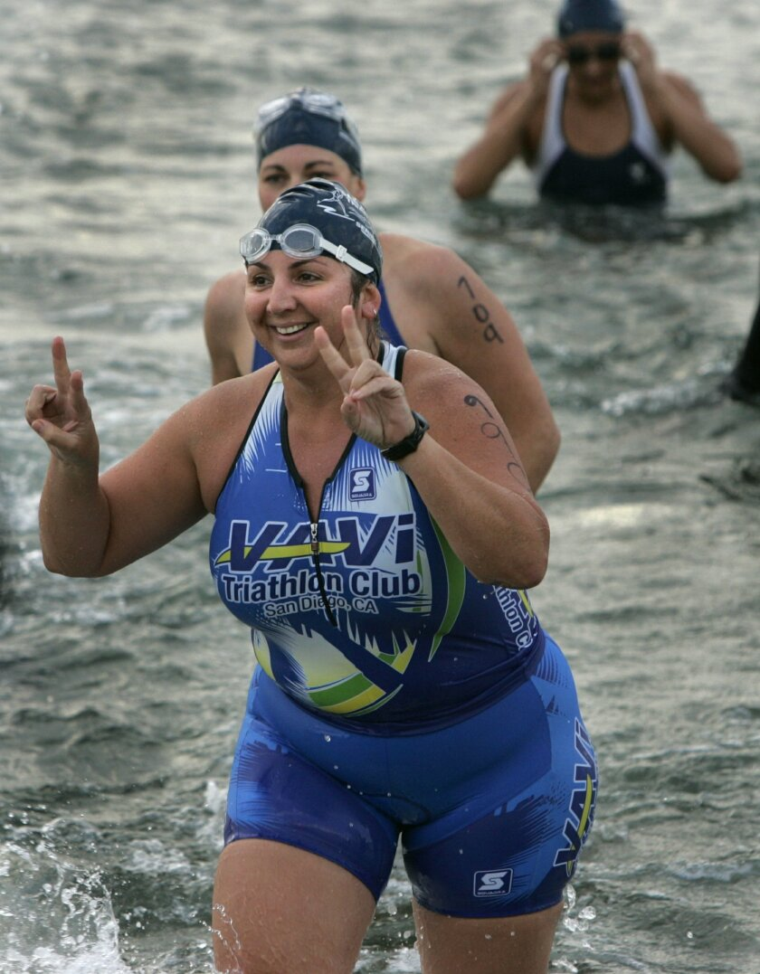 Tanya Llera of Golden Hill flashed the victory sign as she finished the swim in Mission Bay yesterday.