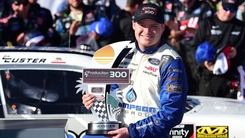 Cole Custer basks in the limelight on Victory Lane after winning the NASCAR Xfinity Series Production Alliance Group 300 at Auto Club Speedway in Fontana on Saturday.