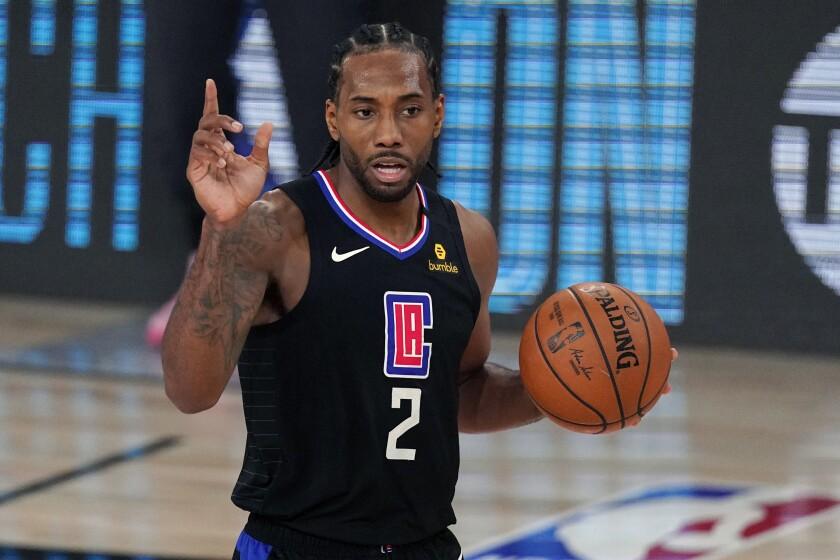 Clippers forward Kawhi Leonard controls the ball during a game.