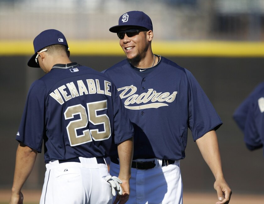 Kyle Blanks chats with Will Venable during the San Diego Padres spring training Sunday.