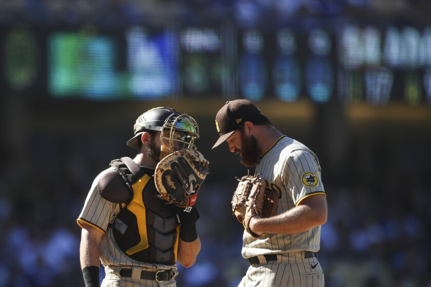 Austin Adams talks with catcher Austin Nola