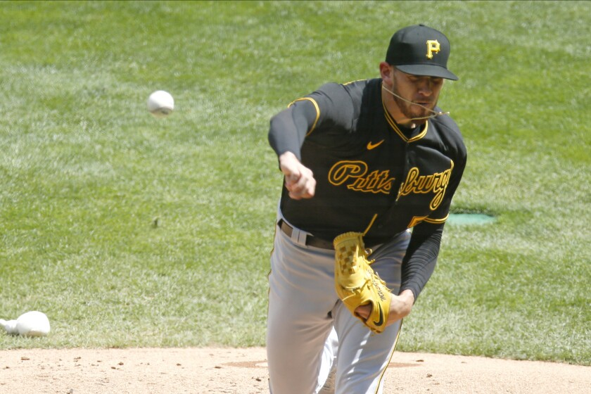 Pittsburgh Pirates pitcher Joe Musgrove throws against the Minnesota Twins in the first inning of a baseball game Tuesday, Aug. 4, 2020, in Minneapolis. (AP Photo/Jim Mone)