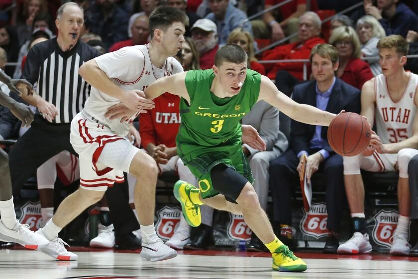Oregon guard Payton Pritchard (3) drives around Utah guard Rylan Jones, left, in the second half during an NCAA college basketball game Saturday, Jan. 4, 2020, in Salt Lake City. (AP Photo/Rick Bowmer)