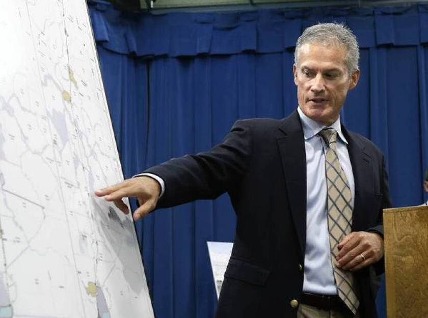 Gordon Enas, the Department of Water Resources principal engineer for the proposed water diversion tunnels for the Sacramento-San Joaquin Delta, gestures to the new proposed tunnel routes at a news conference in Sacramento.