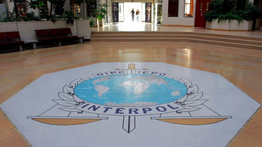 FILE - This Oct.16, 2007 file photo shows the entrance hall of Interpol's headquarters in Lyon, cent