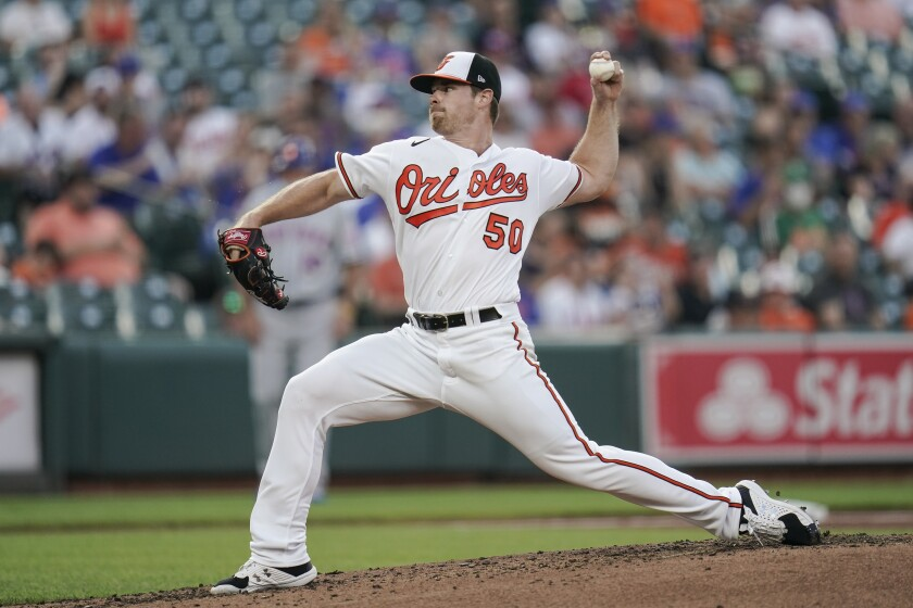 Baltimore Orioles starting pitcher Bruce Zimmermann throws a pitch to the New York Mets during the second inning of a baseball game, Tuesday, June 8, 2021, in Baltimore. (AP Photo/Julio Cortez)