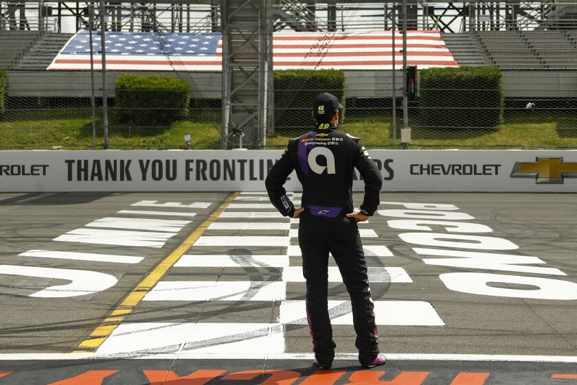 FILE - In this June 28, 2020, file photo, Jimmie Johnson stands at Pocono Raceway in Long Pond, Pa.