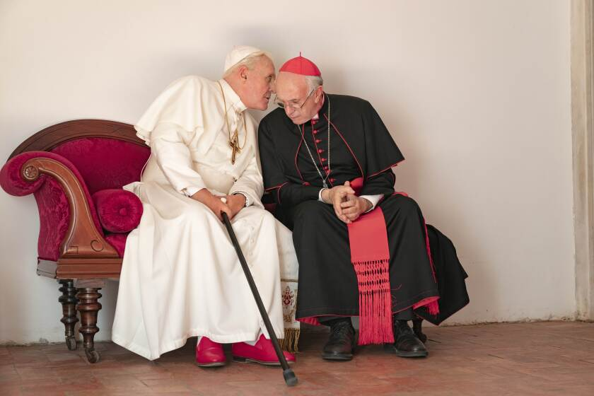 "Anthony Hopkins and Jonathan Pryce star as Pope Benedict and the soon-to-be Pope Francis in ""The Two Popes."""