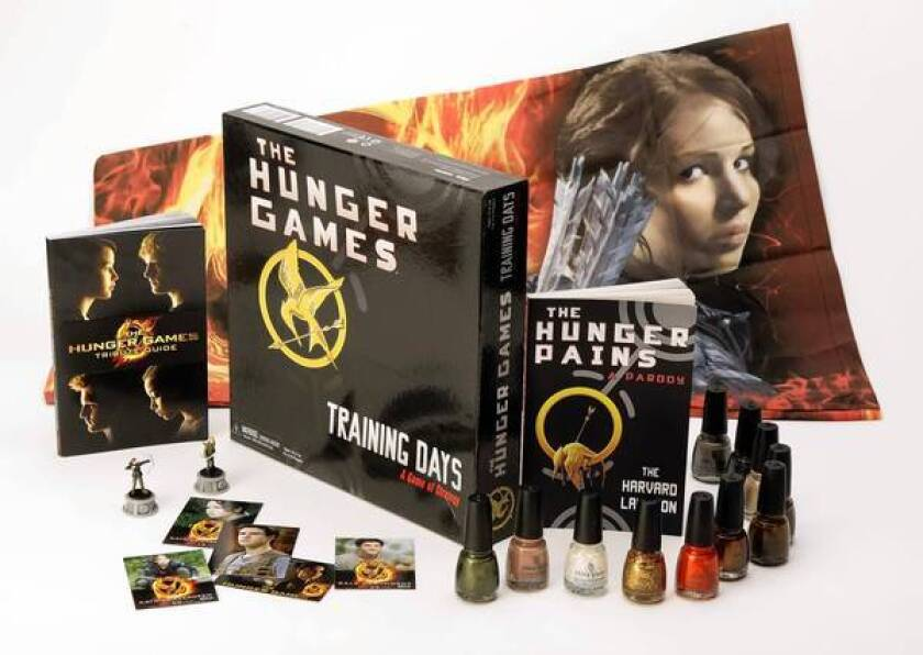 """""""The Hunger Games"""" has inspired a board game, posters, books, toys, nail polish and trading cards."""