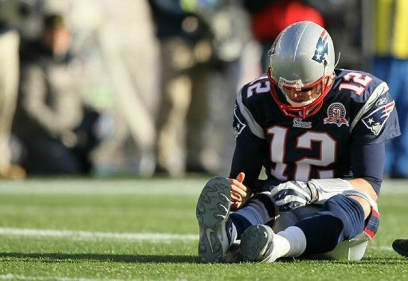 Patriots quarterback Tom Brady was under constant pressure from the Ravens on Sunday and never found a rhythm.