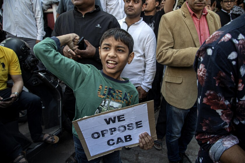 An Indian boy joins in a protest rally during a shutdown against the Citizenship Amendment Bill (CAB) in Gauhati, India, Tuesday, Dec. 10, 2019. Opponents of legislation that would grant Indian citizenship to non-Muslim illegal migrants from Pakistan, Bangladesh and Afghanistan have enforced an 11-hour shutdown across India's northeastern region. (AP Photo/Anupam Nath)
