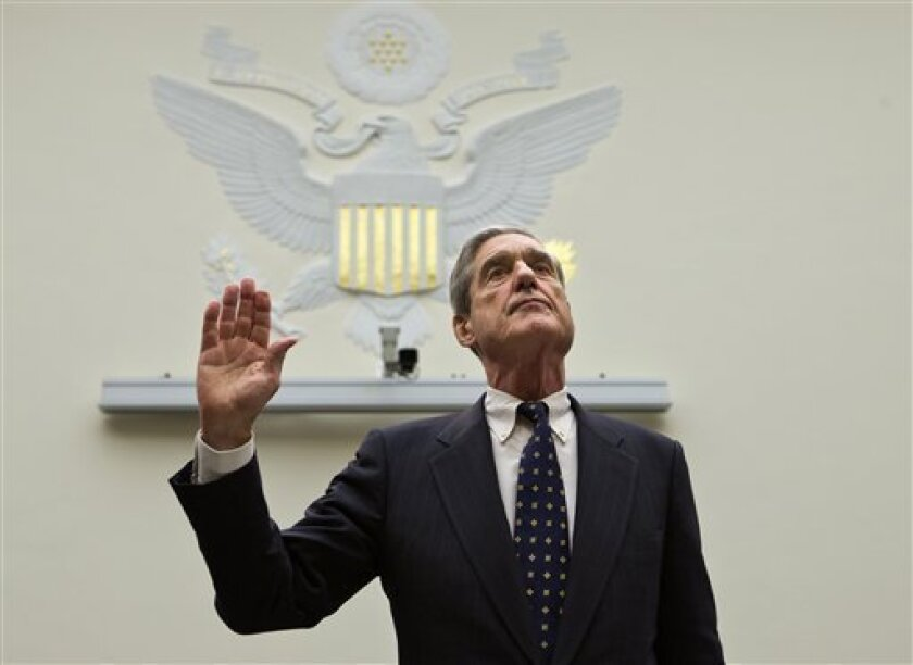 FBI Director Robert Mueller is sworn in on on Capitol Hill in Washington, Thursday, June 13, 2013, prior to testifying before the House Judiciary Committee as it holds an oversight hearing on the FBI. Mueller is nearing the end of his 12 years as head of the law enforcement agency that is conducting high-profile investigations of the Boston Marathon bombings, the attacks in Benghazi, Libya, and leaks of classified government information. The committee's chairman, Rep. Bob Goodlatte, R-Va., said