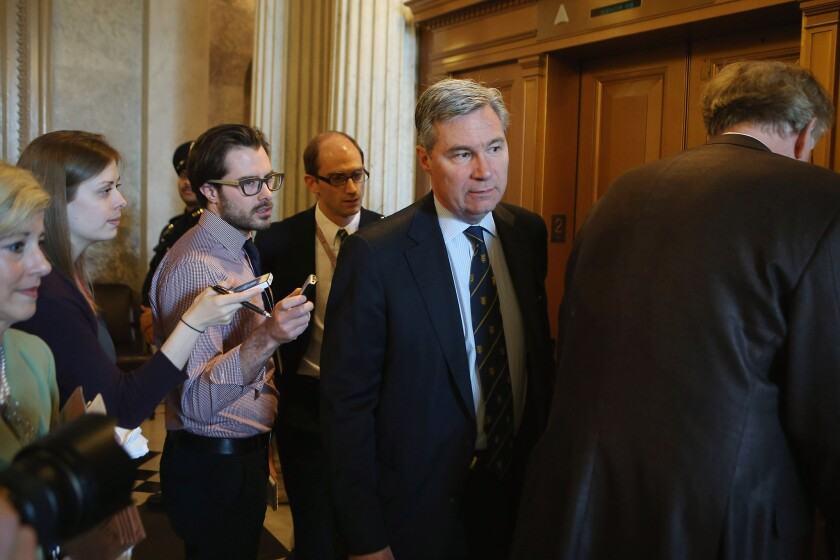 Democratic Sen. Sheldon Whitehouse of Rhode Island leads a group of reporters through the hallway after voting on a series of amendments to the Senate's proposed budget resolution for fiscal 2014 Friday evening.