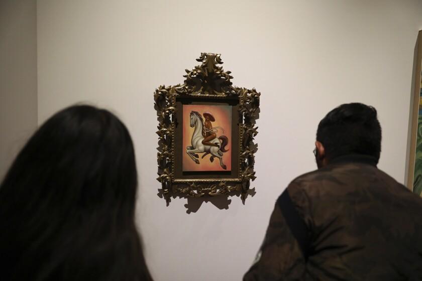 People view a painting of a nude Emiliano Zapata at the Palacio de Bellas Artes