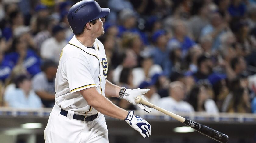 The Padres' Hunter Renfroe hits a two-run home run during the third inning against the Los Angeles Dodgers at Petco Park on Sept. 28, 2016 in San Diego.