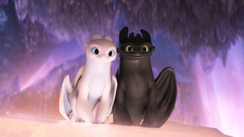 """(L-R) - The female Light Fury dragon and Night Fury dragon Toothless in DreamWorks Animation?s """"How"""