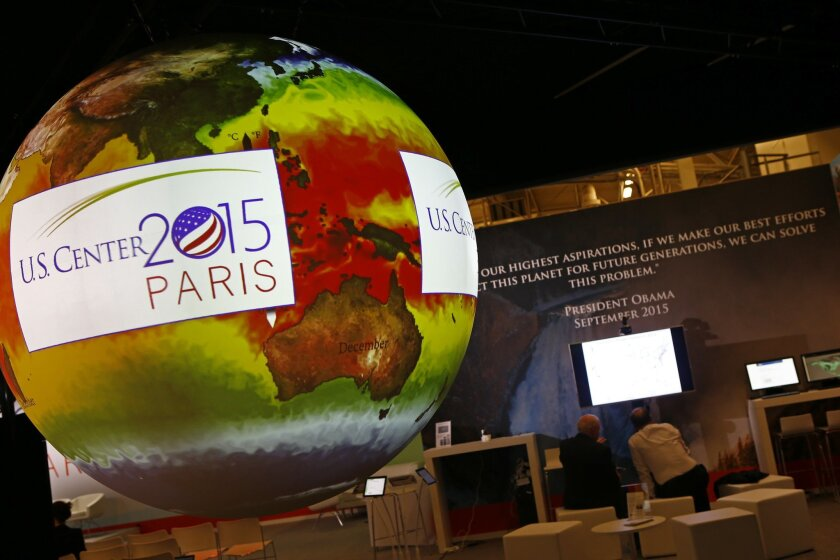 A giant globe displays a video animation during a conference about Antarctic mass change at the U.S. Pavillon during the COP21, United Nations Climate Change Conference, in Le Bourget, outside Paris, Tuesday, Dec. 1, 2015. (AP Photo/Francois Mori)