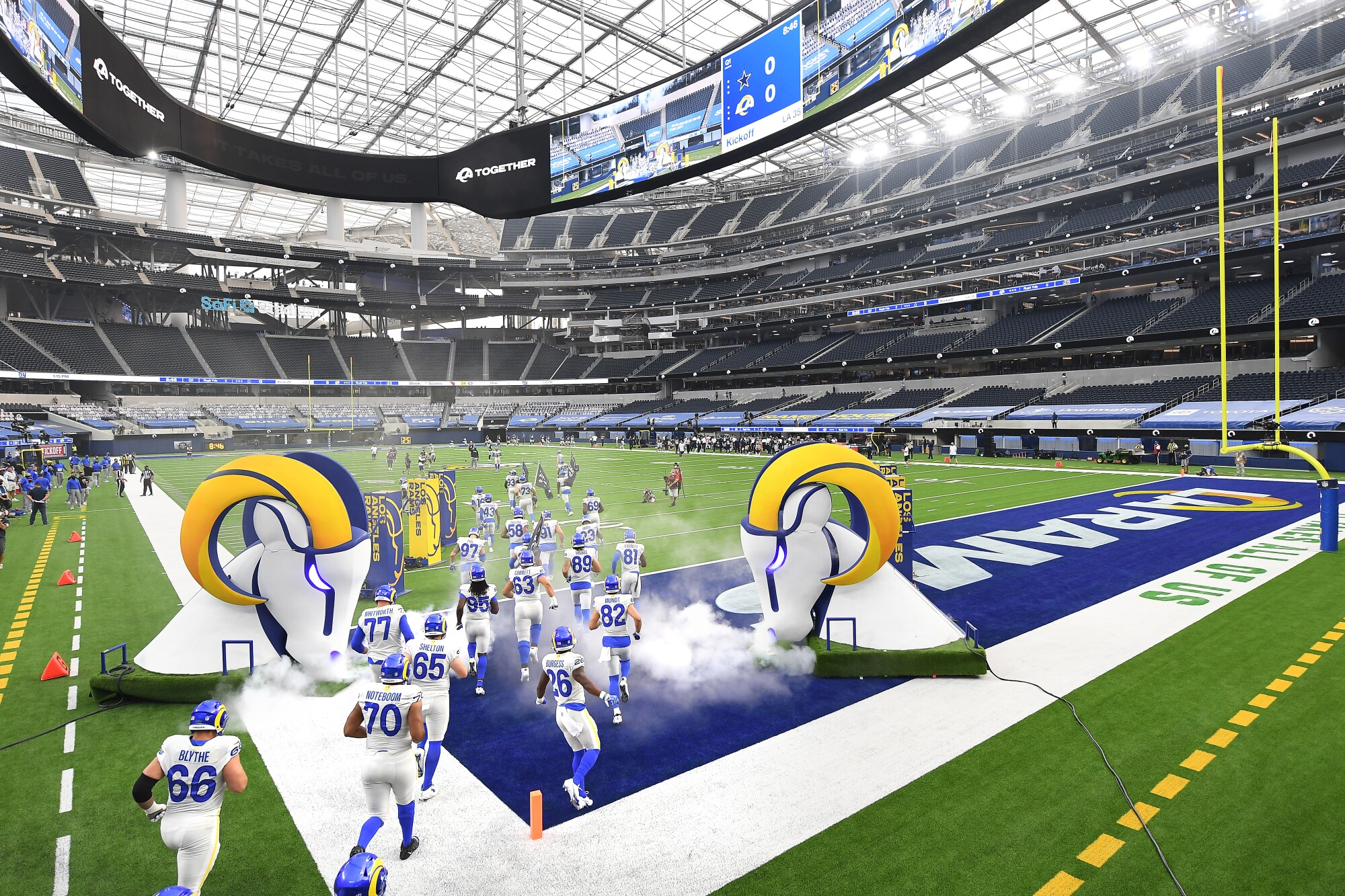 Rams players run onto the field at SoFi Stadium before Sunday's 20-17 win over the Dallas Cowboys.