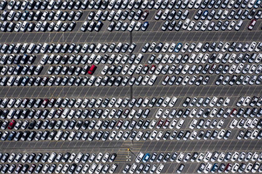 Thousands of new cars on a lot.