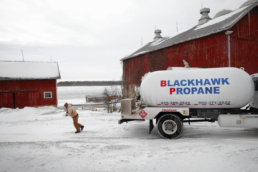 Mark Burger delivers propane to a farm near Clinton, Wis., on Friday. With propane supplies low, prices have shot up.