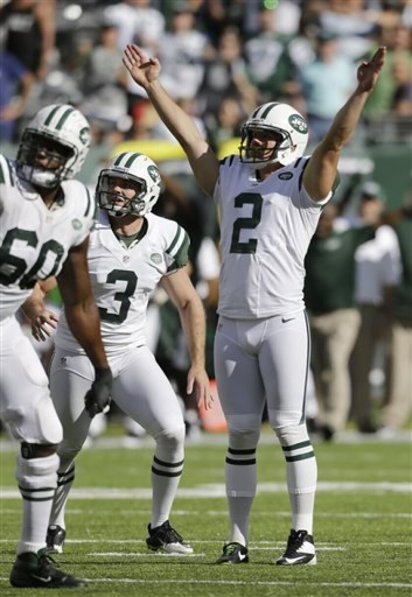 New York Jets' Nick Folk (2) reacts after kicking a 48-yard field goal against the Tampa Bay Buccaneers in the closing seconds of an NFL football game, Sunday, Sept. 8, 2013, in East Rutherford, N.J. The Jets won 18-17. (AP Photo/Mel Evans)