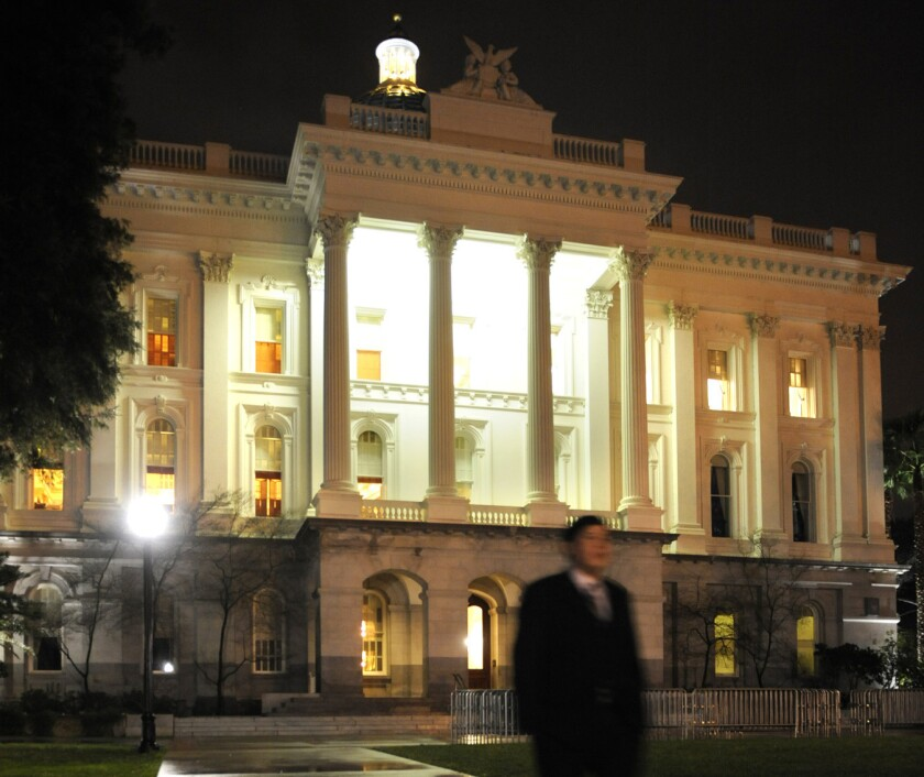 The state Capitol at night. A prominent lobbying firm in Sacramento faces fines for failing to report fundraising that benefited about 40 state legislators and other officials.