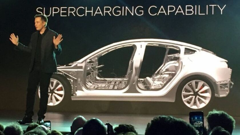 Tesla Motors CEO Elon Musk speaks at the unveiling of the Model 3 on March 31, 2016, in Hawthorne, Calif. Federal regulators are seeking to bar Musk from leadership roles at a company.