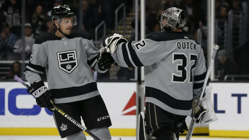 Los Angeles Kings defenseman Dion Phaneuf congratulates goaltender Jonathan Quick, after the team de