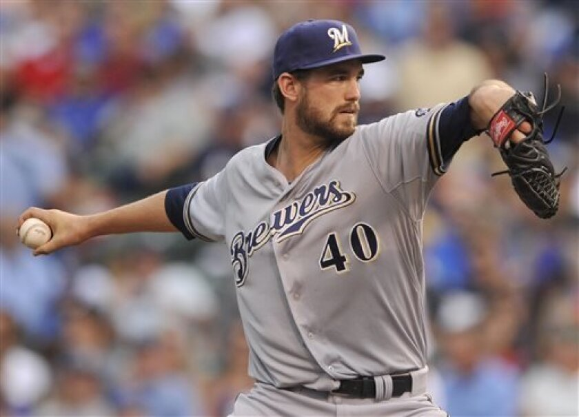 Milwaukee Brewers starter Johnny Hellweg delivers a pitch during the first inning of an MLB baseball game against the Chicago Cubs in Chicago, Saturday, Sept. 7, 2013. (AP Photo/Paul Beaty)