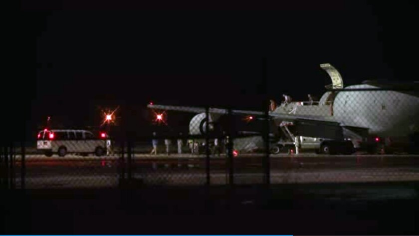 In this image from video, people on Sgt. Bowe Bergdahl's plane are greeted on arrival at Lackland Air Force Base in San Antonio.