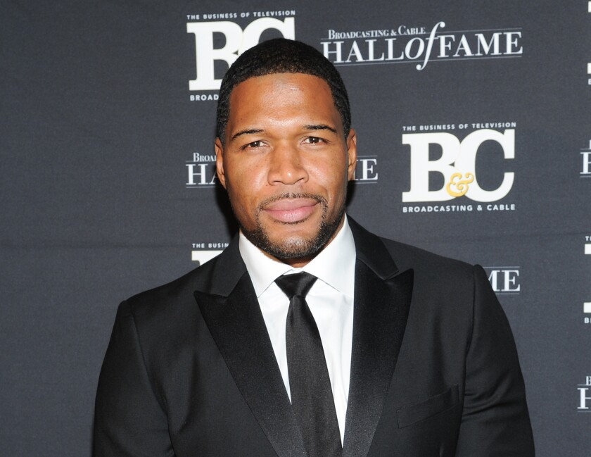 """Former professional football player Michael Strahan, co-host of """"Live With Kelly and Michael,"""" is close to completing a deal to join """"Good Morning America."""""""