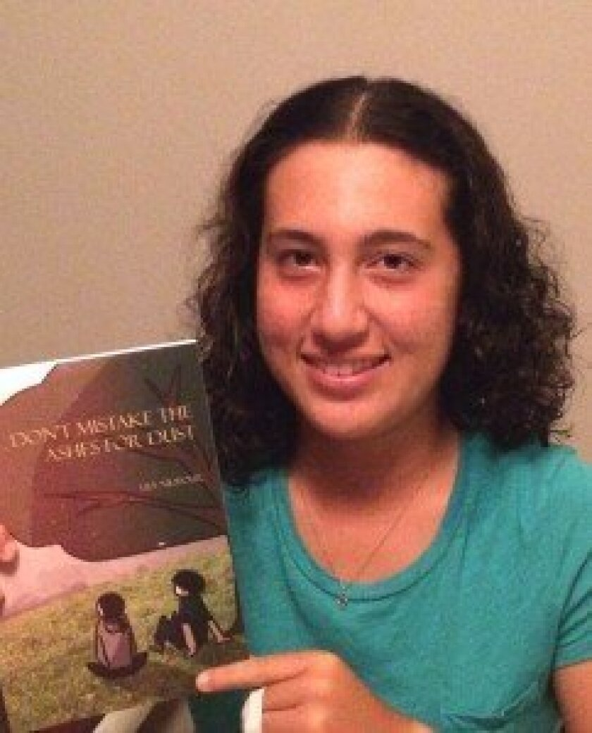 """Lily Nilipour with her book, """"Don't Mistake the Ashes for Dust."""" Courtesy photo"""